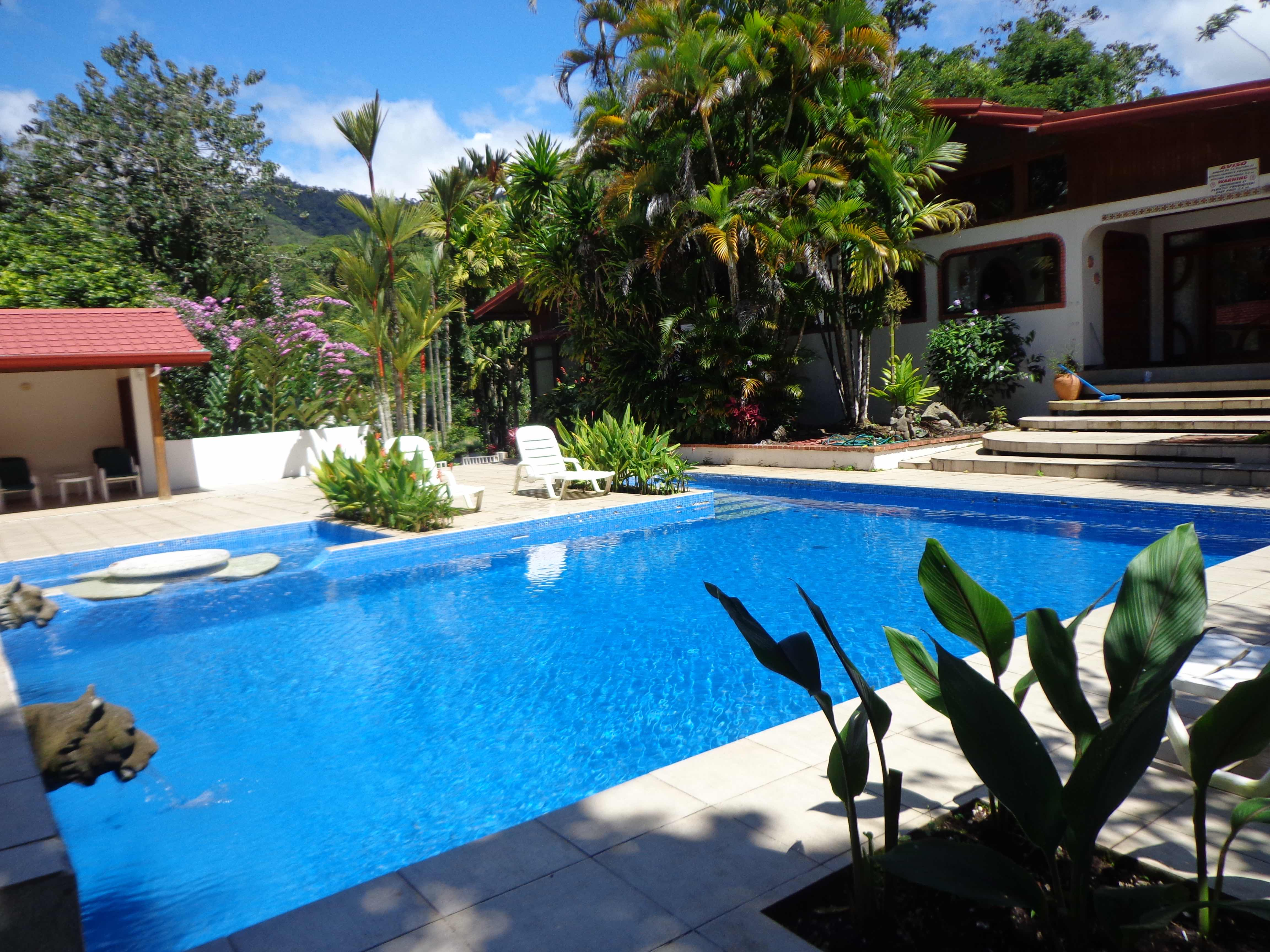 Property nestled in a paradise of tropical gardens