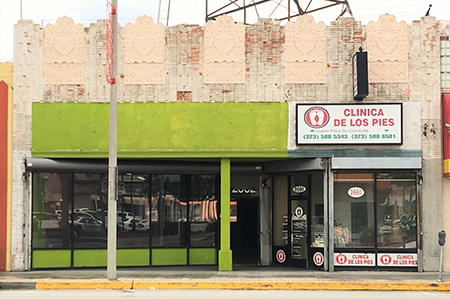 2 Retail Units with Basement and 1 Apartment above for sale in Los Angeles.